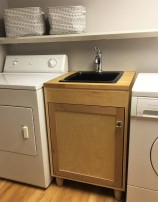 Custom made utility sink cabinet to fit in space.